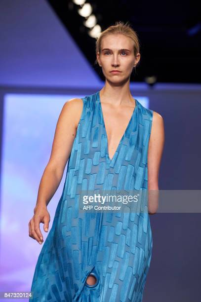 Model Kelly Knox presents a creation by British fashion house Teatum Jones for their Spring/Summer 2018 collection on the first day of London Fashion...