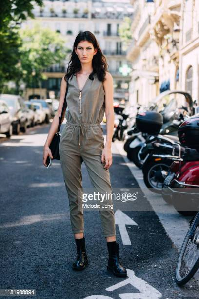 Model Kely Ferr wears a green jumpsuit and black boots after the Jean Paul Gaultier show during Couture Fashion Week Fall/Winter 2019 on July 03,...