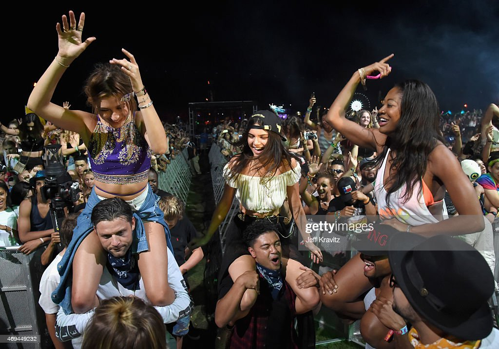 Model Kendall Jenner (top C) and Alfredo Flores (bottom C), Hailey Baldwin (L) and guests in the audience during day 2 of the 2015 Coachella Valley Music & Arts Festival (Weekend 1) at the Empire Polo Club on April 11, 2015 in Indio, California.