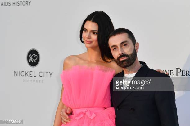 US model Kendall Jenner and italian fashion designer Giambattista Valli pose as they arrive on May 23 2019 at the amfAR 26th Annual Cinema Against...