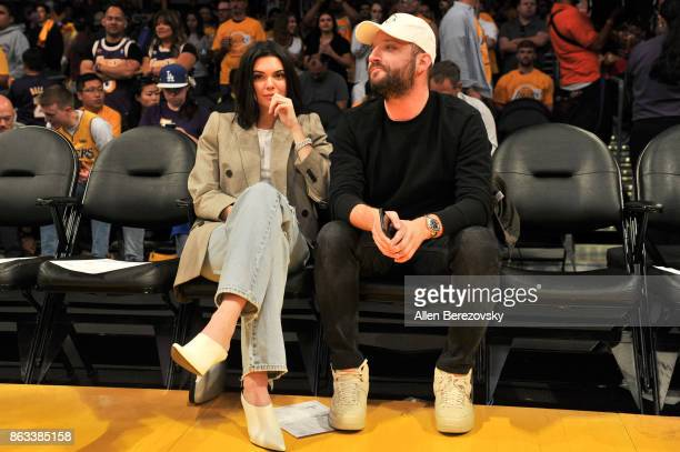 Model Kendall Jenner and producer Michael D Ratner attend a basketball game between the Los Angeles Lakers and the Los Angeles Clippers at Staples...
