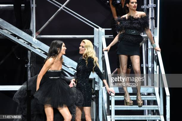 US model Kendall Jenner Belgian model Stella Maxwell and Portuguese model Sara Sampaio perform on stage on May 23 2019 during the amfAR 26th Annual...