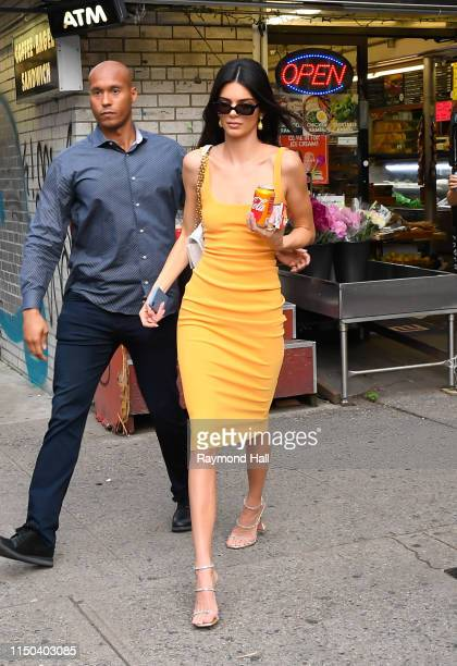 Model Kendall Jenner is seen walking in SoHo with a CocaCola on June 17 2019 in New York City