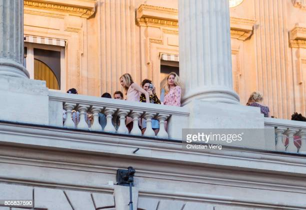Model Kendall Jenner is taking a photo of model Doutzen Kroes outside Miu Miu Cruise Collection during Paris Fashion Week Haute Couture Fall/Winter...