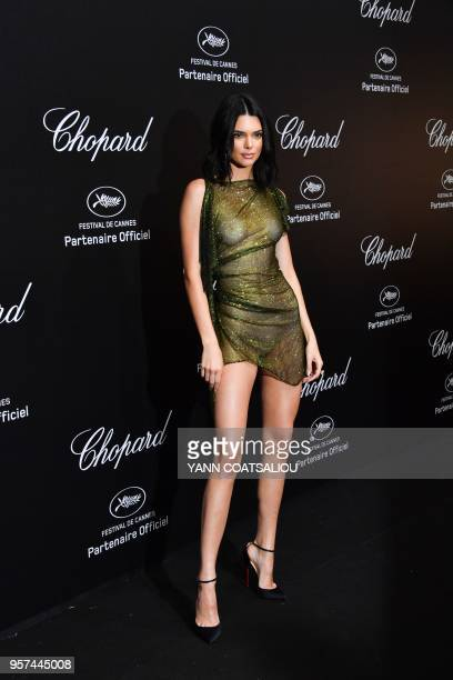 Model Kendall Jenner poses as she arrives on May 11, 2018 for the Chopard Party on the sidelines of the 71st Cannes film festival in Cannes,...