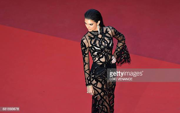 """Model Kendall Jenner poses as she arrives on May 15, 2016 for the screening of the film """"Mal de Pierres """" at the 69th Cannes Film Festival in Cannes,..."""