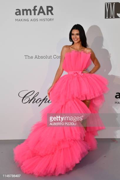 US model Kendall Jenner poses as she arrives on May 23 2019 at the amfAR 26th Annual Cinema Against AIDS gala at the Hotel du CapEdenRoc in Cap...