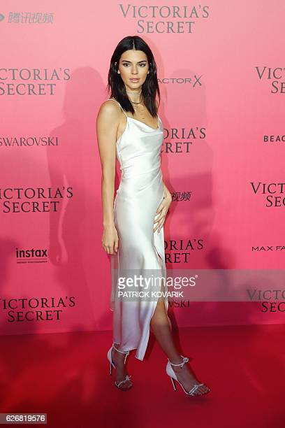 US model Kendall Jenner poses during a photocall after taking part in the 2016 Victoria's Secret Fashion Show at the Grand Palais in Paris on...