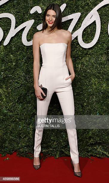 US model Kendall Jenner poses for pictures on the red carpet upon arrival to attend the British Fashion Awards 2014 in London on December 1 2014 AFP...