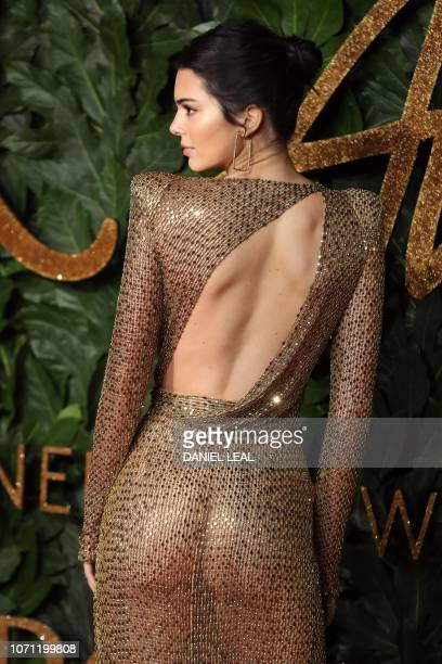 Model Kendall Jenner poses on the red carpet upon arrival to attend the British Fashion Awards 2018 in London on December 10, 2018. - The Fashion...