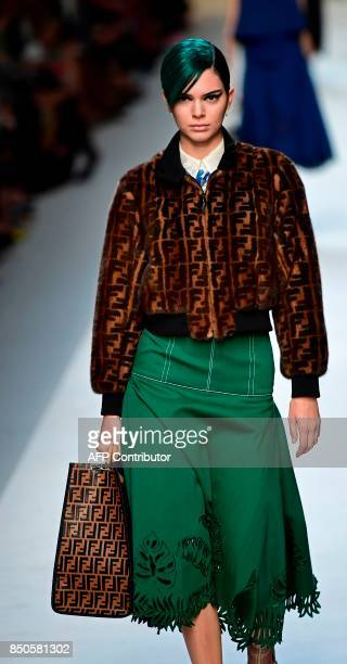 Model Kendall Jenner presents a creation for fashion house Fendi during the Women's Spring/Summer 2018 fashion shows in Milan on September 21 2017 /...