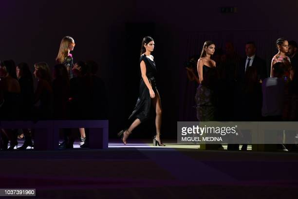 Model Kendall Jenner presents a creation for Versace fashion house during the Women's Spring/Summer 2019 fashion shows in Milan on September 21 2018