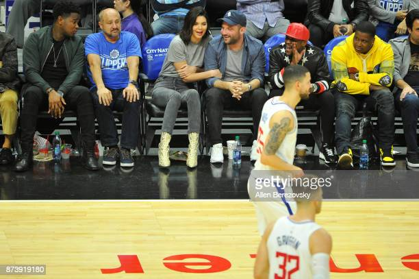 Model Kendall Jenner producer Michael D Ratner and boxer Floyd Mayweather attend a basketball game between the Los Angeles Clippers and the...