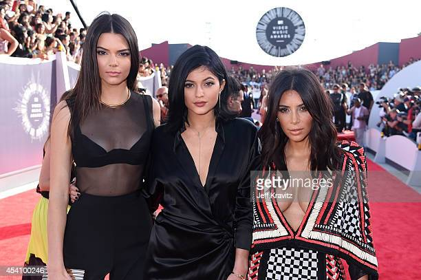 Model Kendall Jenner TV personalities Kylie Jenner and Kim Kardashian attend the 2014 MTV Video Music Awards at The Forum on August 24 2014 in...