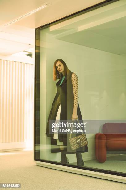 Model poses at a fashion shoot for Madame Figaro on July 22 2017 in Paris France Sleeveless coat dress and pants earrings bag boots PUBLISHED IMAGE...