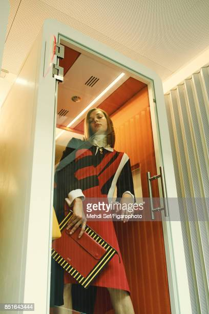 Model Kersti Pohlak poses at a fashion shoot for Madame Figaro on July 22 2017 in Paris France Dress sweater necklace clutch PUBLISHED IMAGE CREDIT...