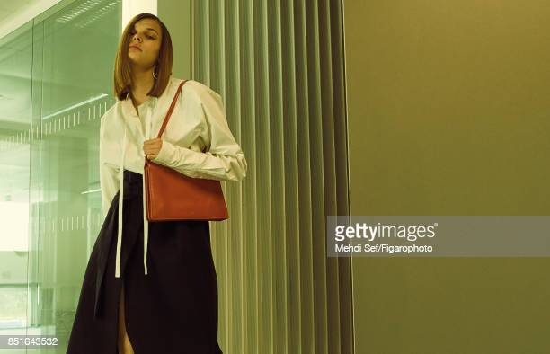 Model Kersti Pohlak poses at a fashion shoot for Madame Figaro on July 22 2017 in Paris France Dress belt and bag earring PUBLISHED IMAGE CREDIT MUST...