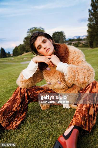 Model Kiki Boreel poses at a fashion shoot for Madame Figaro on June 22 2017 in EvianlesBains France Coat shirt and pants boots PUBLISHED IMAGE...