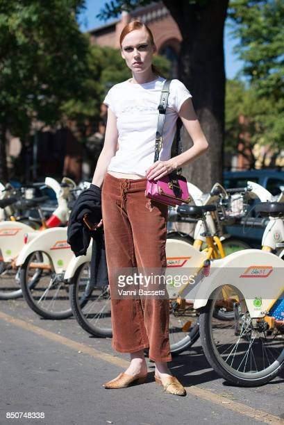 Model Kiki Willems poses with a Prada bag after the Fendi show during Milan Fashion Week Spring/Summer 2018 on September 21 2017 in Milan Italy