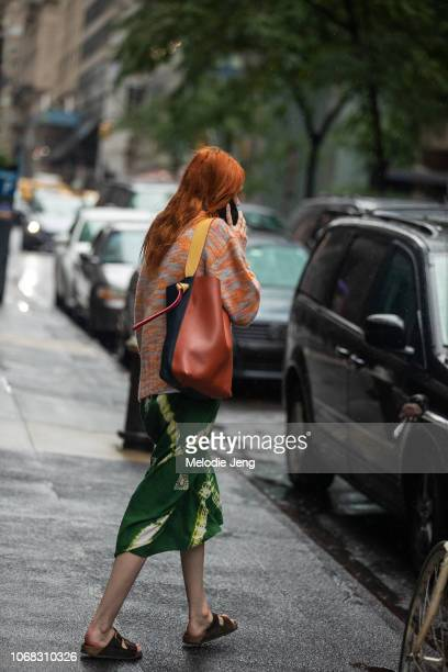 Model Kiki Willems talks on the phone and carries a Proenza Schouler bag at the Sies Marjan show during New York Fashion Week Spring/Summer 2019 on...