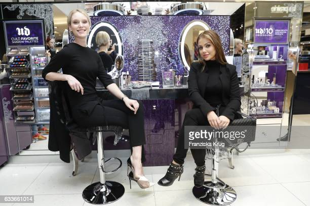 Model Kim Hnizdo and ItGirl Kim Gloss attend the Urban Decay ReOpening at KaDeWe Berlin on February 3 2017 in Berlin Germany