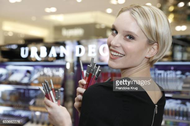 Model Kim Hnizdo attends the Urban Decay ReOpening at KaDeWe Berlin on February 3 2017 in Berlin Germany