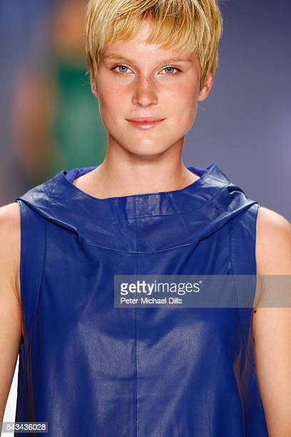 Model Kim Hnizdo walks the runway at the Riani show during the MercedesBenz Fashion Week Berlin Spring/Summer 2017 at Erika Hess Eisstadion on June...
