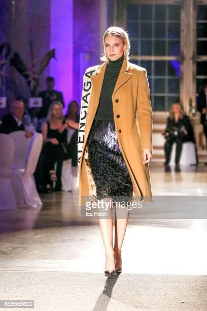 Model Kim Hnizdo walks the runway during the Minx Fashion Night in favour of 'Sauti Kuu' of Auma Obama at Wuerzburger Residenz on September 23 2017...
