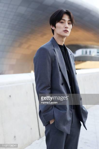 Model Kim HyungKwon wearing grey suit black blazer inside and white sneakers is seen at the Hera Seoul Fashion Week 2019 F/W at Dongdaemun Design...