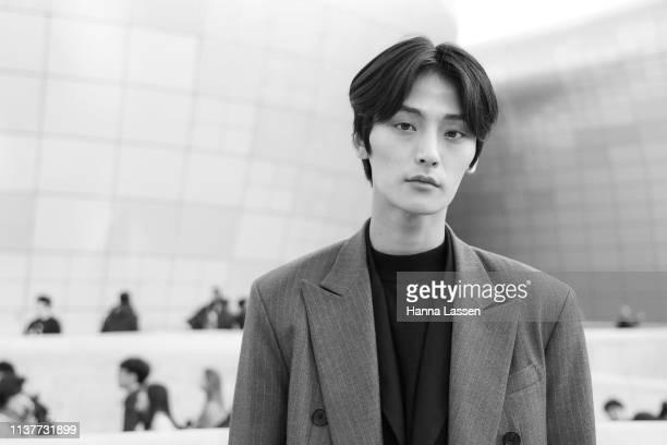 Model Kim HyungKwon wearing grey suit black blazer inside and white sneakers at Seoul Fashion Week 2019 F/W at Dongdaemun Design Plaza at Dongdaemun...