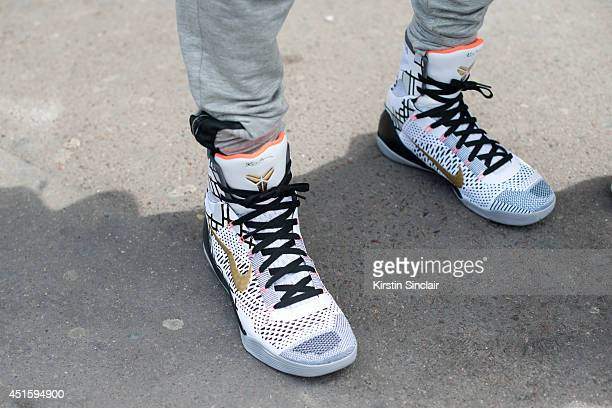 Model Kir They William wearing Kobe Bryant trainers LMDR pants on day 2 of Paris Collections Men on June 26 2014 in Paris France