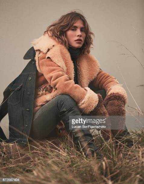 Model Klaudia K poses at a fashion shoot for Madame Figaro on September 12, 2017 in Paris, France. Jean jacket , coat and cardigan , jeans , scarf ,...