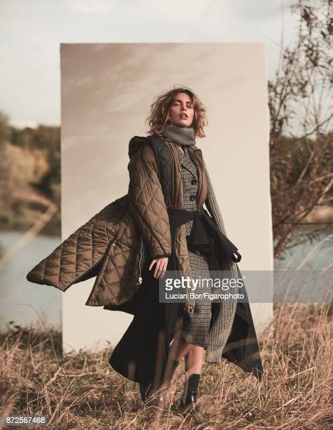 Model Klaudia K poses at a fashion shoot for Madame Figaro on September 12 2017 in Paris France Outer parka inner parka suit and scarf windbreaker...
