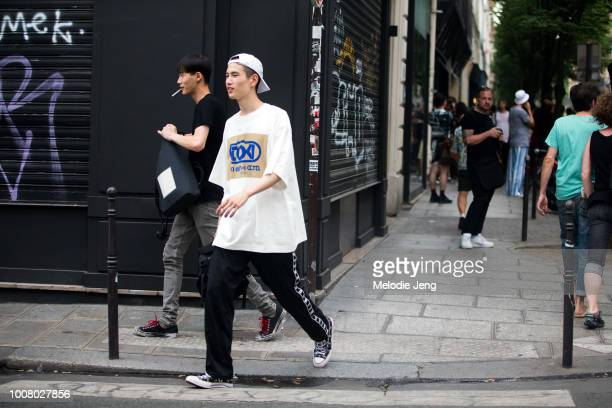 Model Kohei Takabatake a white backwards baseball cap white Dries Van Noten TOKI Toki Seni Co Ltd tshirt black Balenciaga joger pants and black JW...