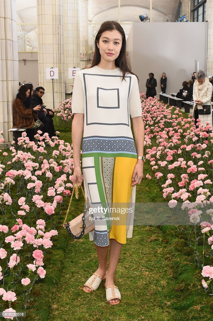 Model Kouka Webb attends the Tory Burch Fall Winter 2018 Fashion Show during New York Fashion Week at Bridge Market on February 9, 2018 in New York City.