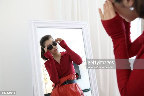 Model Kouka Webb prepares backstage at the Kering Suite during The 70th Cannes Film Festival on May 24 2017 in Cannes France