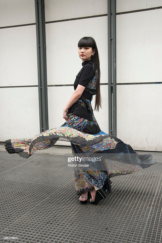 Model Kozue Akimoto wears all Sacai on day 7 of Paris Collections: Women on March 09, 2015 in Paris, France.