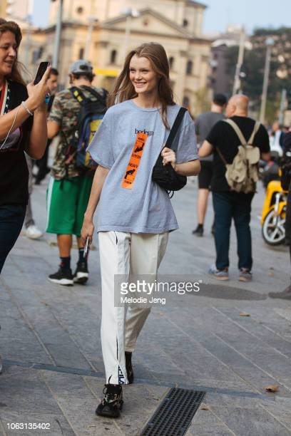 Model Kris Grikaite wears a gray bodega tshirt with a heavy sticker white Fila pants and black Valentino sneakers during Milan Fashion Week...
