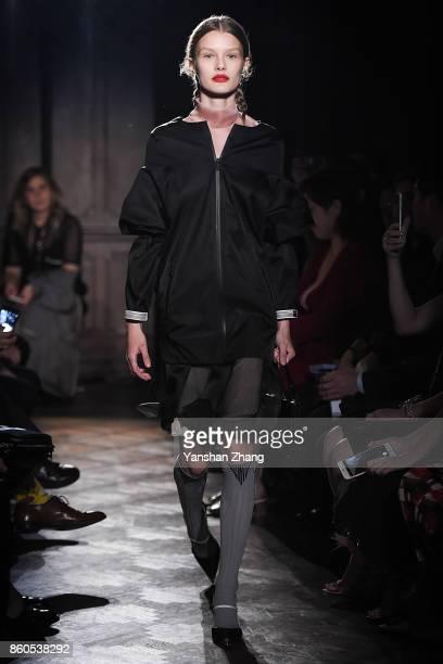 Model Kris Griktaite walks the runway during Prada 2018 Resort Fashion Show at Prada Rong Zhai on October 12 2017 in Shanghai China