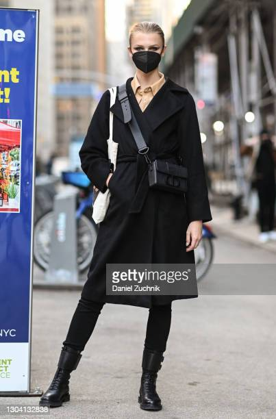 Model Kylie Vonnahme is seen wearing a black coat, tan shirt, black pants and boots with a Christian Dior bag outside the Christian Siriano show...