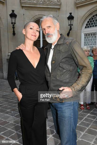 Model Lada Vesna and Jean Marie Marion attend Ruben Alterio Paintings Exhibition Preview at Mairie du 1er Arrondissement on May 30 2017 in Paris...