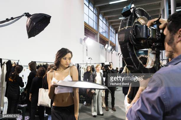 Model Lameka Fox poses for a photographer backstage before the Akris show at Palais de Tokyo as part of the Paris Fashion Week Womenswear Fall/Winter...