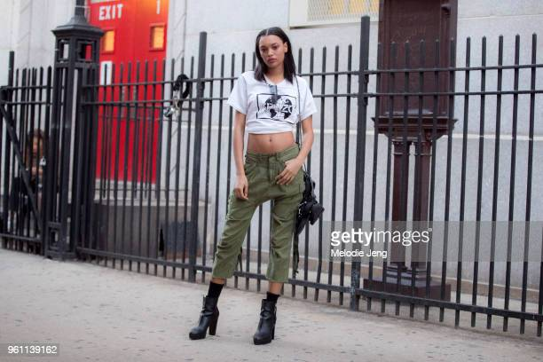 Model Lameka Fox wears a cropped Kenzo t-shirt, green capris, and black boots during New York Fashion Week Spring/Summer 2018 on September 9, 2017 in...