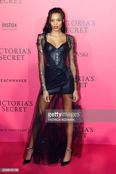 US model Lameka Foxposes during a photocall after taking part in the 2016 Victoria's Secret Fashion Show at the Grand Palais in Paris on November 30...