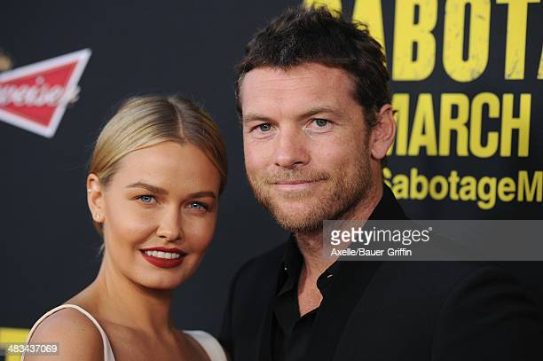 Model Lara Bingle and actor Sam Worthington arrive at the Los Angeles premiere of 'Sabotage' at Regal Cinemas LA Live on March 19 2014 in Los Angeles...