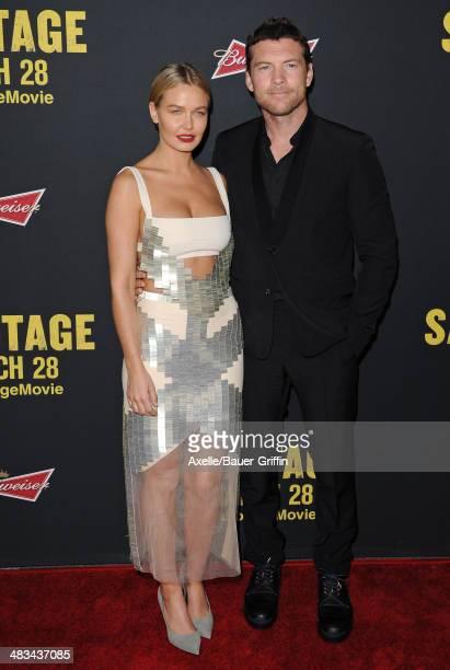 Model Lara Bingle and actor Sam Worthington arrive at the Los Angeles premiere of 'Sabotage' at Regal Cinemas LA Live on March 19 2014 in Los Angeles...