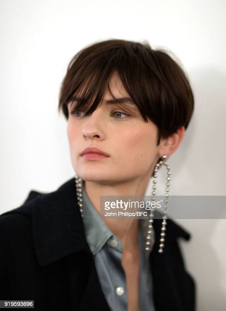 Model Lara Mullen backstage ahead of the House of Holland show during London Fashion Week February 2018 at TopShop Show Space on February 17 2018 in...