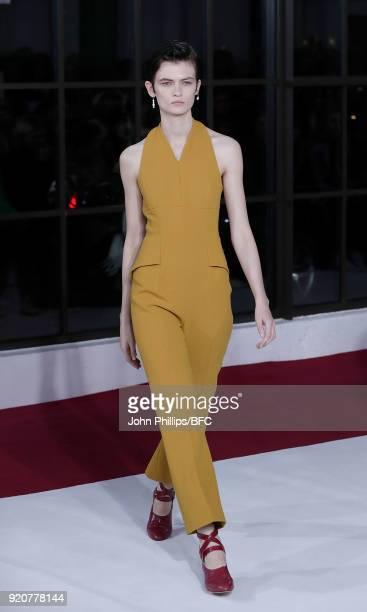 Model Lara Mullen walks the runway at the Emilia Wickstead show during London Fashion Week February 2018 at Great Portland Street on February 19 2018...