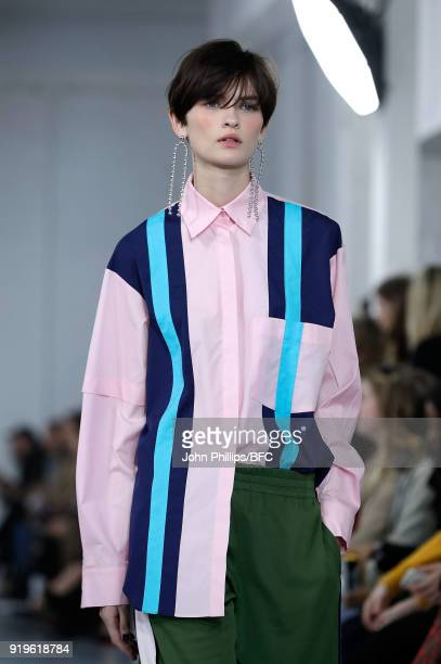 Model Lara Mullen walks the runway at the House of Holland show during London Fashion Week February 2018 at TopShop Show Space on February 17 2018 in...