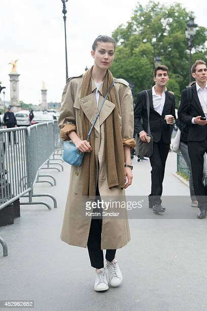 Model Larissa Hoffman wearing a Burberry trench coat Miu Miu bag and Adida trainers day 3 of Paris Haute Couture Fashion Week Autumn/Winter 2014 on...